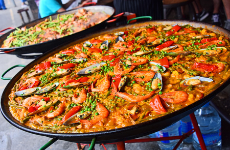 Spanish paella prepared in the street restaurant.