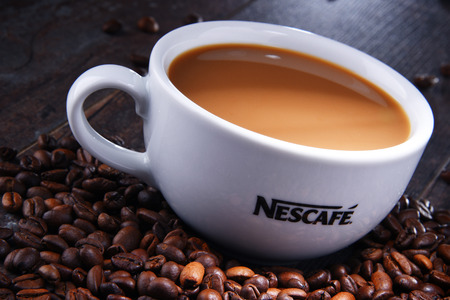 POZNAN, POLAND - AUG 3, 2018: Cup of Nescafe coffee, a brand of Swiss coffee made by Nestle, introduced in 1938