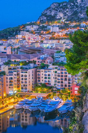 View of the city of Monaco on French Riviera after sunset. 免版税图像
