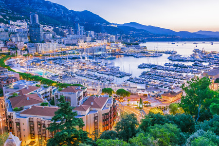 View of the city of Monaco on French Riviera after sunset. Stock Photo
