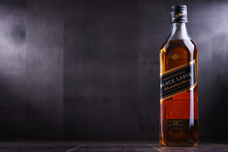 POZNAN, POL - SEP 27, 2018: Bottle of Johnnie Walker, the most widely distributed brand of blended Scotch whisky in the world with sales of over 130 million bottles a year. Sajtókép