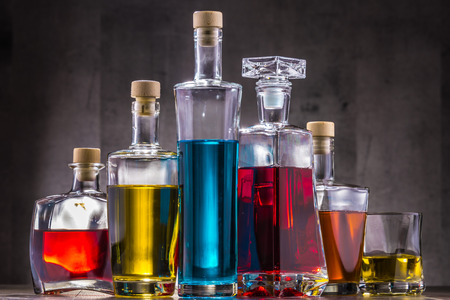 Composition with carafe and bottles of assorted alcoholic beverages. Stock Photo