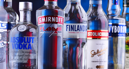 POZNAN, POLAND - NOV 15, 2018: Bottles of several global brands of vodka, the world's largest internationally traded spirit with the estimated sale of about 500 million nine-liter cases a year. Editorial
