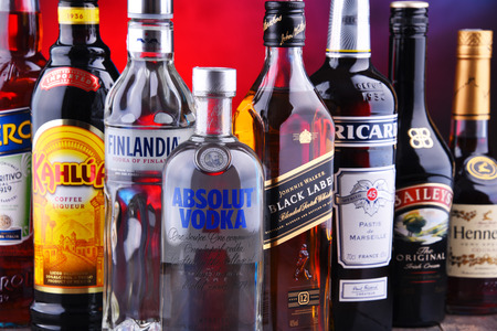 POZNAN, POLAND - NOV 16, 2018: Bottles of assorted global liquor brands including whiskey, vodka, cognac and liqueur