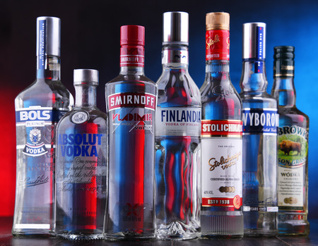 POZNAN, POLAND - NOV 15, 2018: Bottles of several global brands of vodka, the world's largest internationally traded spirit with the estimated sale of about 500 million nine-liter cases a year.