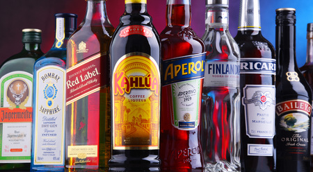 POZNAN, POLAND - NOV 16, 2018: Bottles of assorted global liquor brands including whiskey, vodka, gin, cognac and liqueur