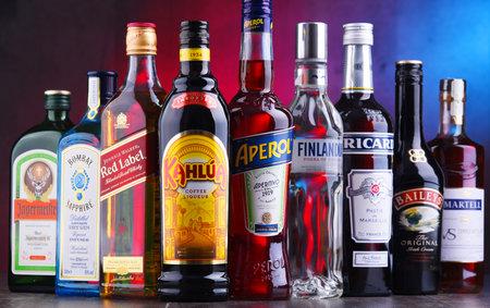 POZNAN, POLAND - NOV 16, 2018: Bottles of assorted global liquor brands including whiskey, vodka, gin, cognac and liqueur Editorial