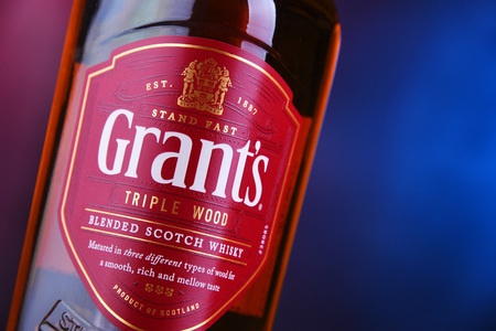 POZNAN, POL - NOV 29, 2018: Bottle of Grants whisky, the oldest family-owned blended whisky, bottled by William Grant & Sons in Scotland, currently sold in over 180 countries.