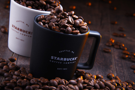 POZNAN, POL - NOV 29, 2018: Cups of Starbucks, coffee company and coffeehouse chain, founded in Seattle, Wa. USA, in 1971; now the largest business of this kind in the world operates 28,218 locations