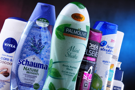 POZNAN, POLAND - DEC 5, 2018: Plastic containers of body care products including widely available most popular global brands as LOreal, Nivea, Dove, Palmolive, Head & Shoulders and Schwarzkopf