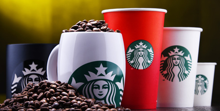 POZNAN, POL - DEC 30, 2018: Cups of Starbucks, the name of coffee company and coffeehouse chain, founded in Seattle, Wa. USA, in 1971; now the largest business of this kind in the world.