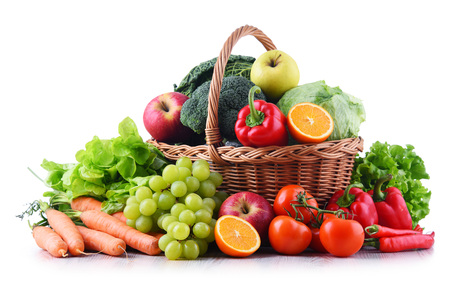Fresh organic fruits and vegetables in wicker basket isolated on white Banco de Imagens