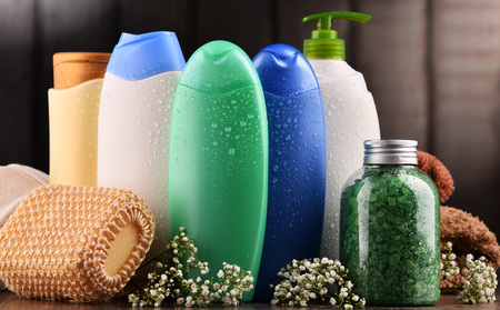 Plastic bottles of body care and beauty products. Фото со стока