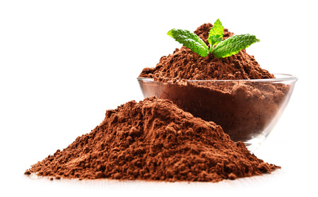 Composition with bowl of cocoa powder isolated on white.
