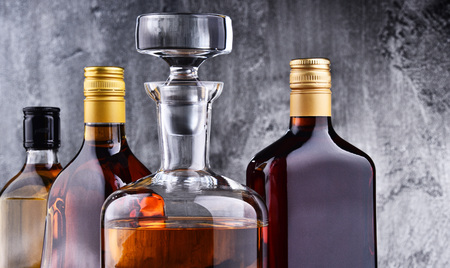 Composition with carafe and bottles of assorted alcoholic beverages. Stok Fotoğraf
