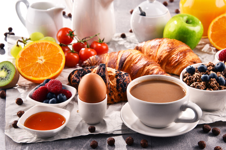 Breakfast served with coffee, orange juice, croissants, egg, cereals and fruits. Balanced diet. Stock Photo - 115655753