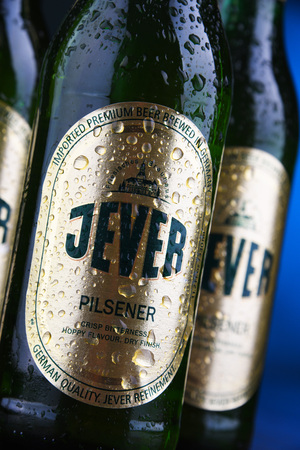 POZNAN, POL - DEC 12, 2018: Bottles Jever, a popular brand of beer produced by Friesisches Brauhaus in Jever, Friesland in Lower Saxony, Germany