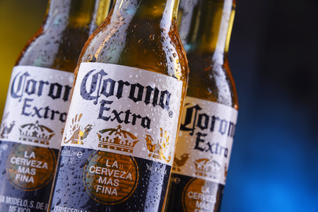 POZNAN, POL - JAN 24, 2019: Bottles of Corona Extra, one of the top-selling beers worldwide, a pale lager produced by Cerveceria Modelo in Mexico Editorial