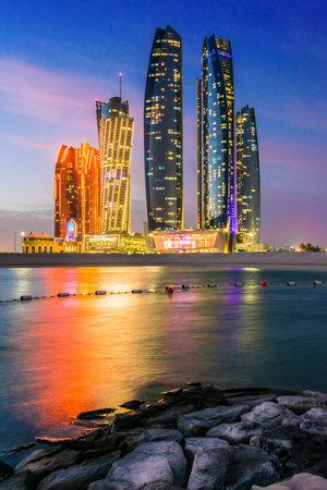 ABU DHABI, UNITED ARAB EMIRATES - FEB 10, 2019: Etihad Towers in Abu Dhabi, United Arab Emirates after sunset