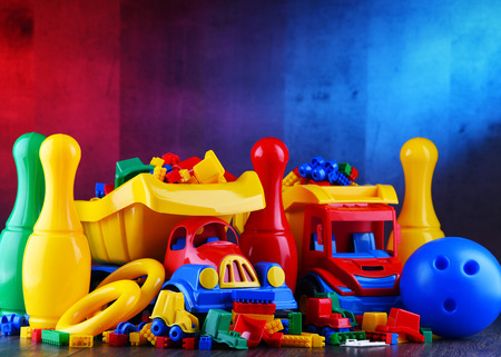 Composition with colorful plastic children toys. Фото со стока