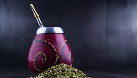Composition with yerba mate cup and leaves.