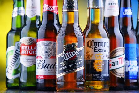 POZNAN, POL - MAR 15, 2019: Bottles of famous global beer brands including Bud, Miller, Corona, Stella Artois, and San Miguel