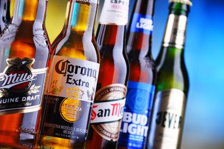 POZNAN, POL - MAR 15, 2019: Bottles of famous global beer brands including Bud, Miller, Corona and San Miguel