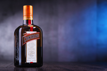 POZNAN, POL - MAR 22, 2019: Bottle of Cointreau, a brand of French triple sec (an orange-flavoured liqueur); great component of several well-known cocktails, also drunk as an aperitif and digestif
