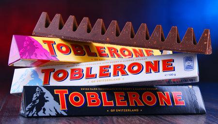 POZNAN, POL - MAR 22, 2019: Three bars of Toblerone, a Swiss chocolate brand owned by US confectionery company Mondelez International, Inc.