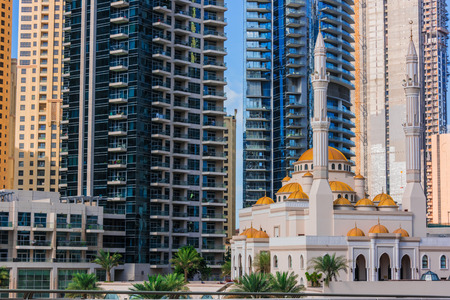 Modern residential architecture of Dubai Marina and Mohammed Bin Ahmed Almulla Mosque, United Arab Emirates. Stok Fotoğraf