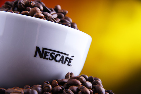 POZNAN, POLAND - MAR 29, 2019: Cup of Nescafe coffee, a brand of Swiss coffee made by Nestle and introduced in 1938 Foto de archivo - 122640040