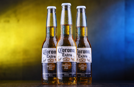 POZNAN, POL - MAR 28, 2019: Bottles of Corona Extra, one of the top-selling beers worldwide, a pale lager produced by Cerveceria Modelo in Mexico