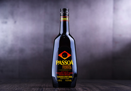POZNAN, POL - MAR 28, 2019: Bottle of Passoa, a passion-fruit liqueur made in France, invented in 1985 에디토리얼