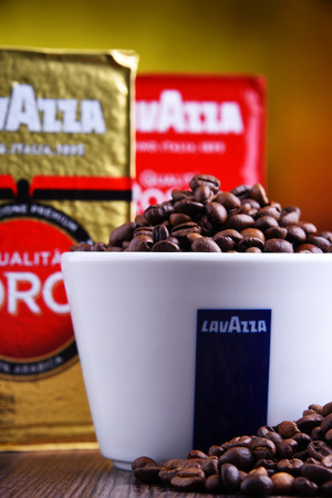 POZNAN, POLAND - MAR 29, 2019: Cup of Lavazza coffee, a brand owned by an Italian manufacturer of coffee products, founded in Turin in 1895 by Luigi Lavazza. Foto de archivo - 122640076