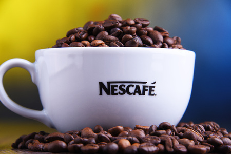 POZNAN, POLAND - MAR 29, 2019: Cup of Nescafe coffee, a brand of Swiss coffee made by Nestle and introduced in 1938 Foto de archivo - 122640079