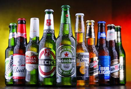 POZNAN, POL - MAR 15, 2019: Bottles of famous global beer brands including Heineken, Becks, Bud, Miller, Corona, Stella Artois, and San Miguel Editorial