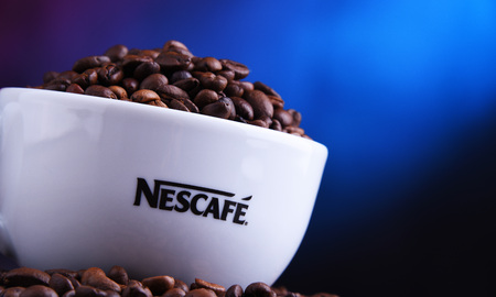 POZNAN, POLAND - MAR 29, 2019: Cup of Nescafe coffee, a brand of Swiss coffee made by Nestle and introduced in 1938 Foto de archivo - 122640094