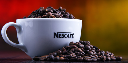 POZNAN, POLAND - MAR 29, 2019: Cup of Nescafe coffee, a brand of Swiss coffee made by Nestle and introduced in 1938 Foto de archivo - 122640108
