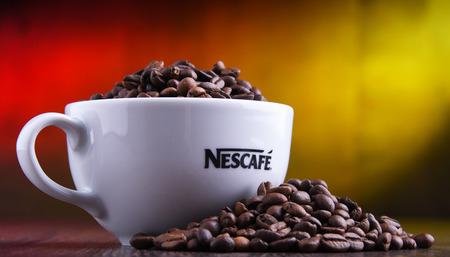 POZNAN, POLAND - MAR 29, 2019: Cup of Nescafe coffee, a brand of Swiss coffee made by Nestle and introduced in 1938 Foto de archivo - 122640117