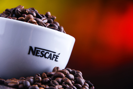 POZNAN, POLAND - MAR 29, 2019: Cup of Nescafe coffee, a brand of Swiss coffee made by Nestle and introduced in 1938 Foto de archivo - 122640121