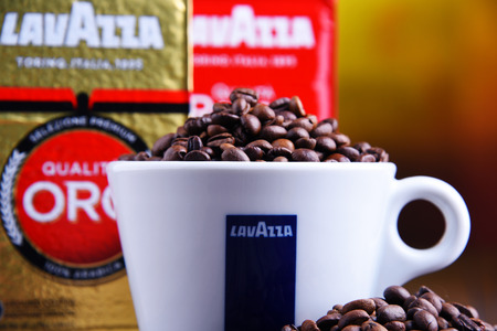 POZNAN, POLAND - MAR 29, 2019: Cup of Lavazza coffee, a brand owned by an Italian manufacturer of coffee products, founded in Turin in 1895 by Luigi Lavazza. Foto de archivo - 122640129