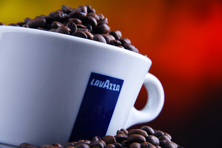 POZNAN, POLAND - MAR 29, 2019: Cup of Lavazza coffee, a brand owned by an Italian manufacturer of coffee products, founded in Turin in 1895 by Luigi Lavazza. Foto de archivo - 122640130