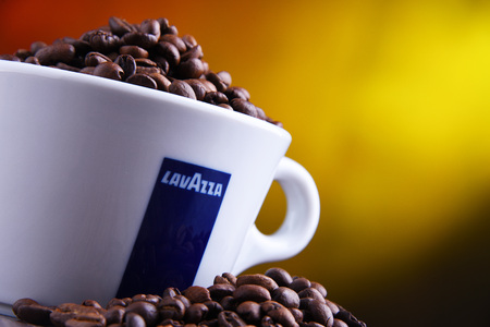 POZNAN, POLAND - MAR 29, 2019: Cup of Lavazza coffee, a brand owned by an Italian manufacturer of coffee products, founded in Turin in 1895 by Luigi Lavazza. Foto de archivo - 122640161