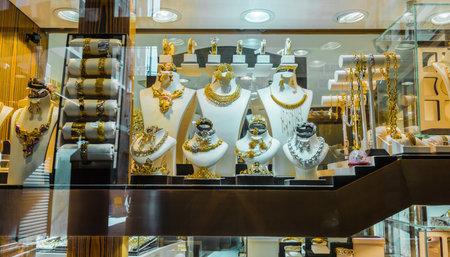 DUBAI, UNITED ARAB EMIRATES - FEB 7, 2019: Show window of a jewelry store in Dubai Gold Souk, United Arab Emirates.