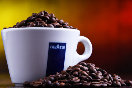 POZNAN, POLAND - MAR 29, 2019: Cup of Lavazza coffee, a brand owned by an Italian manufacturer of coffee products, founded in Turin in 1895 by Luigi Lavazza. Foto de archivo - 122640179