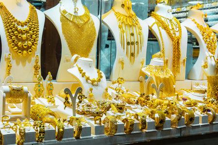 DUBAI, UNITED ARAB EMIRATES - FEB 7, 2019: Show window of a jewelry store in Dubai Gold Souk, United Arab Emirates. Editorial