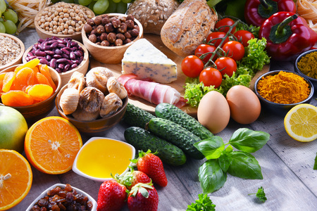 Composition with assorted organic food products on wooden kitchen table. Stock fotó