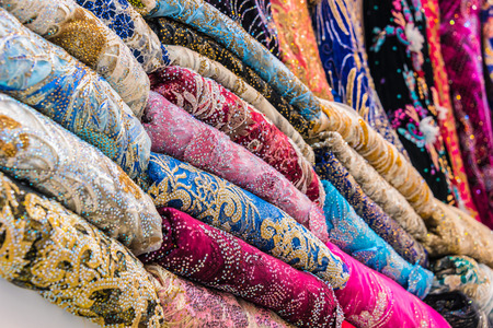 Traditional oriental cloth sold in a store in old town Dubai, United Arab Emirates Stock Photo - 123731321