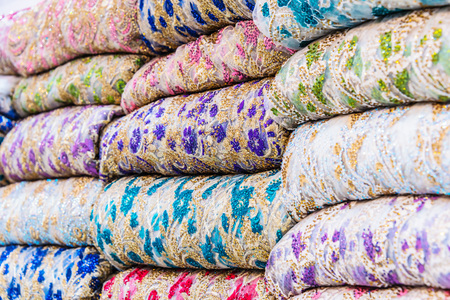 Traditional oriental cloth sold in a store in old town Dubai, United Arab Emirates Stock Photo - 123731179