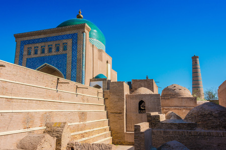 Historic architecture of Itchan Kala, walled inner town of the city of Khiva, Uzbekistan. Stockfoto